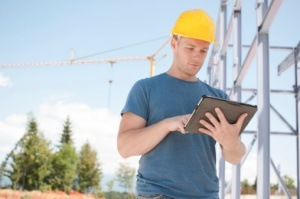 Engineer reviewing plans on digital tablet